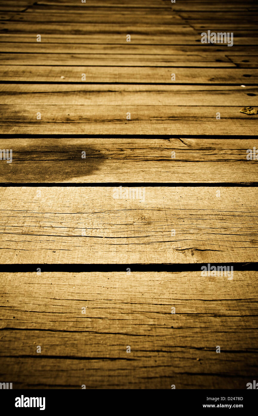wood planks of a an old wooden bridge - Stock Image