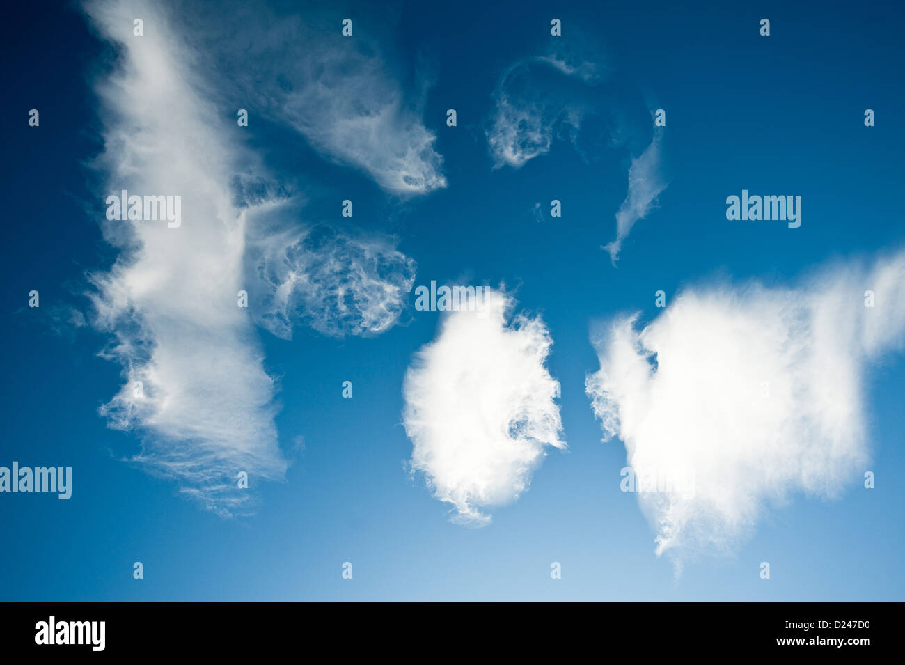 Bright blue sky with puffy white clouds. Cloudscape. - Stock Image