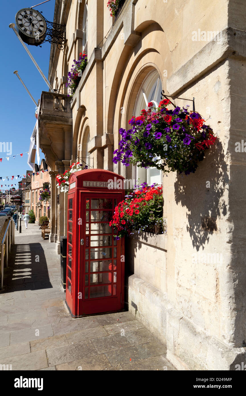 A red telephone box outside Corsham Town Hall in Wiltshire, England. Stock Photo