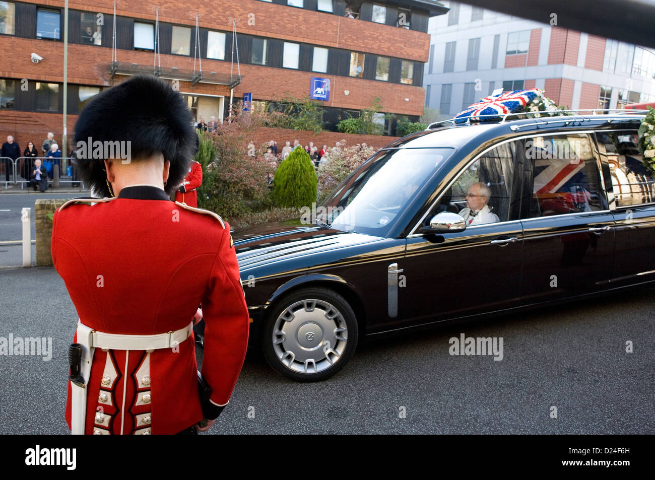 A British Guards soldier in formal dress at a military funeral in Croydon. - Stock Image