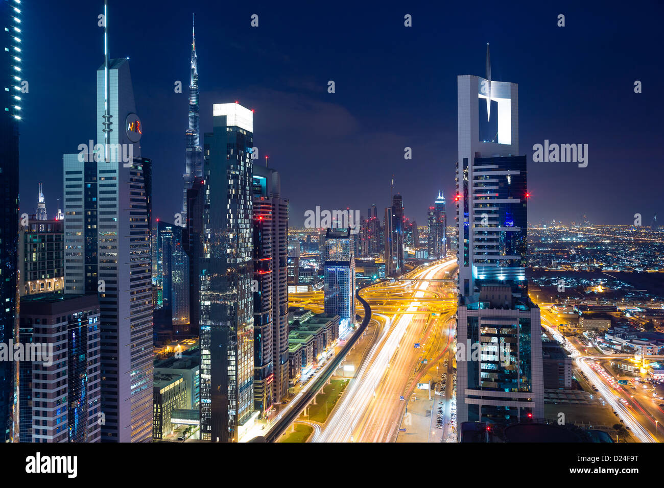 Dubai modern city skyline view at sunset, night with copy space. View from rooftop looking downtown Sheik Zayed - Stock Image