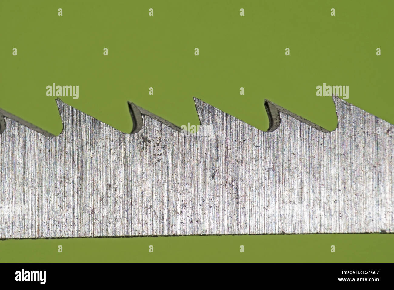 Macro shot of a cutting blade used in a jigsaw power tool - Stock Image