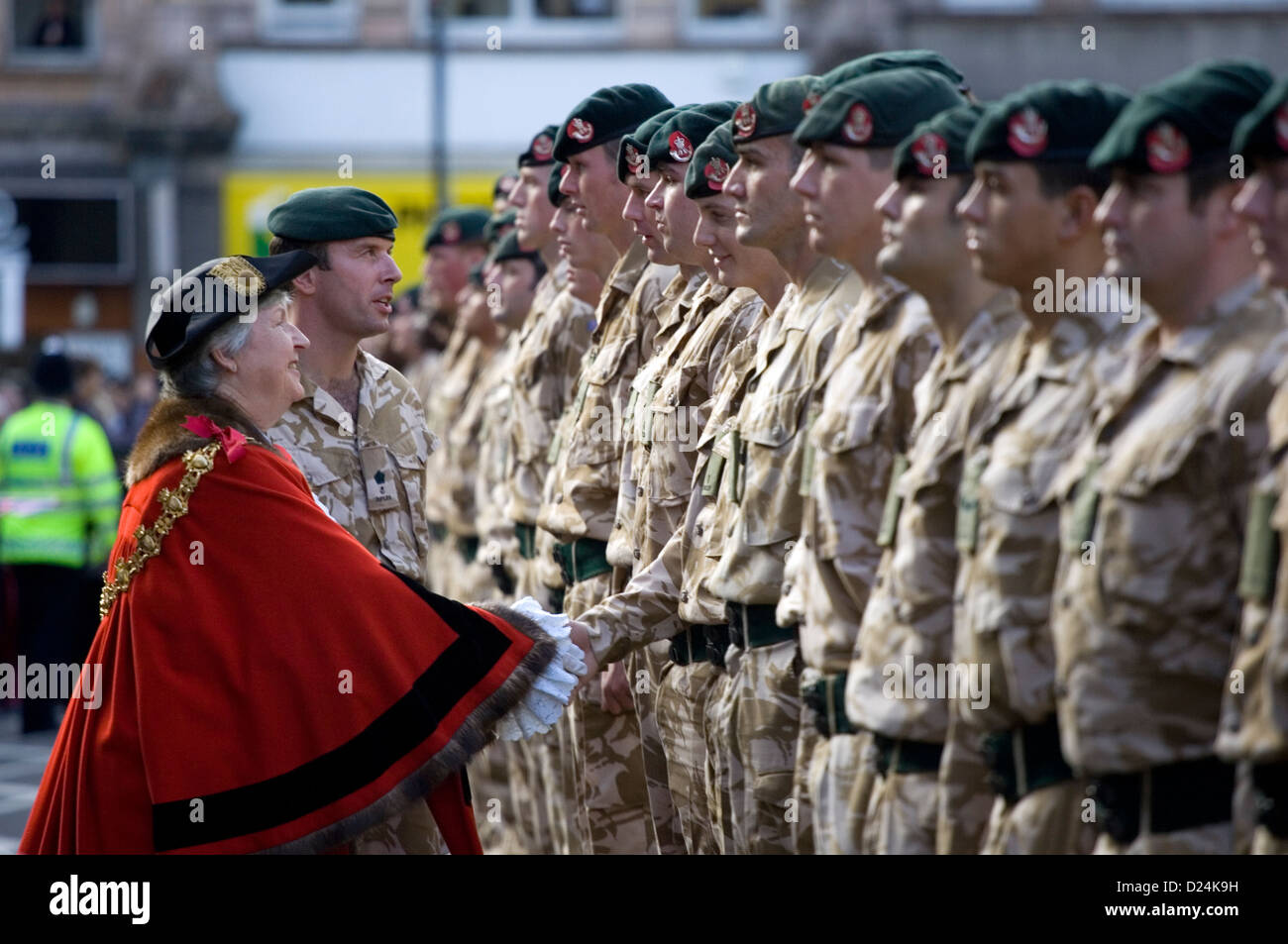 The Mayor greeting members of the British army. - Stock Image
