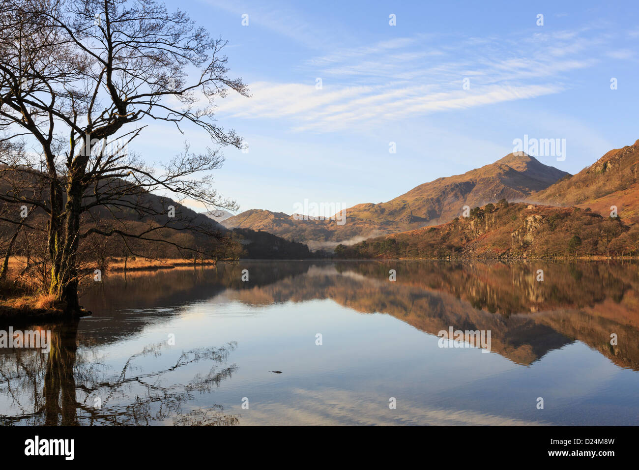 View to Yr Aran with reflections in still tranquil waters of Llyn Gwynant lake in mountains of Snowdonia National Park landscape. North Wales UK Stock Photo