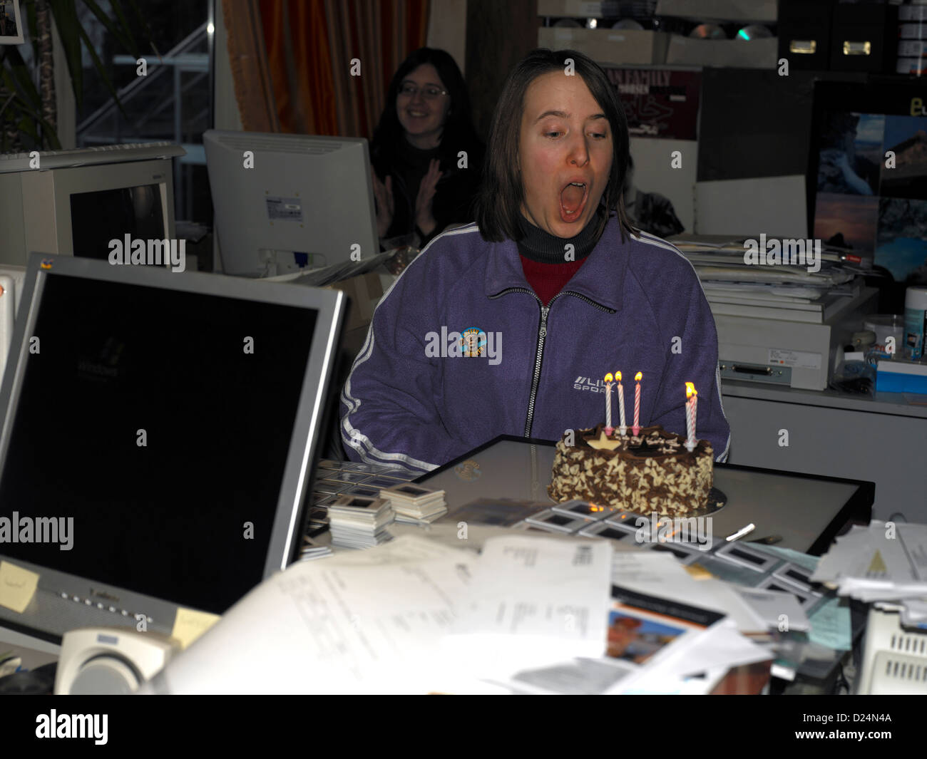 Birthday In Office With Birthday Cake Candles And Computers Stock