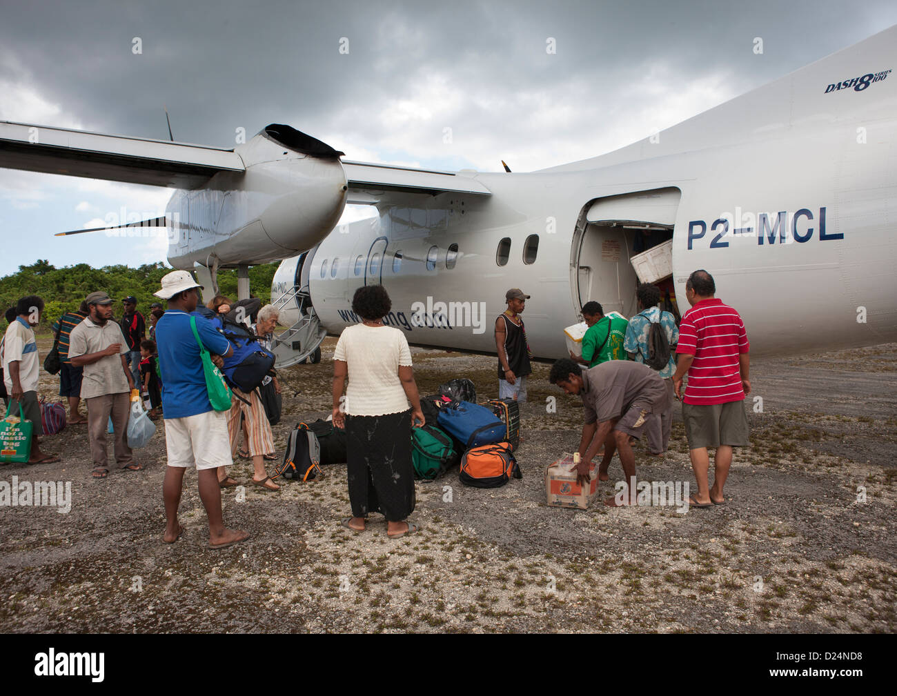 Plane Arriving In Airport, Trobriand Island, Papua New Guinea - Stock Image