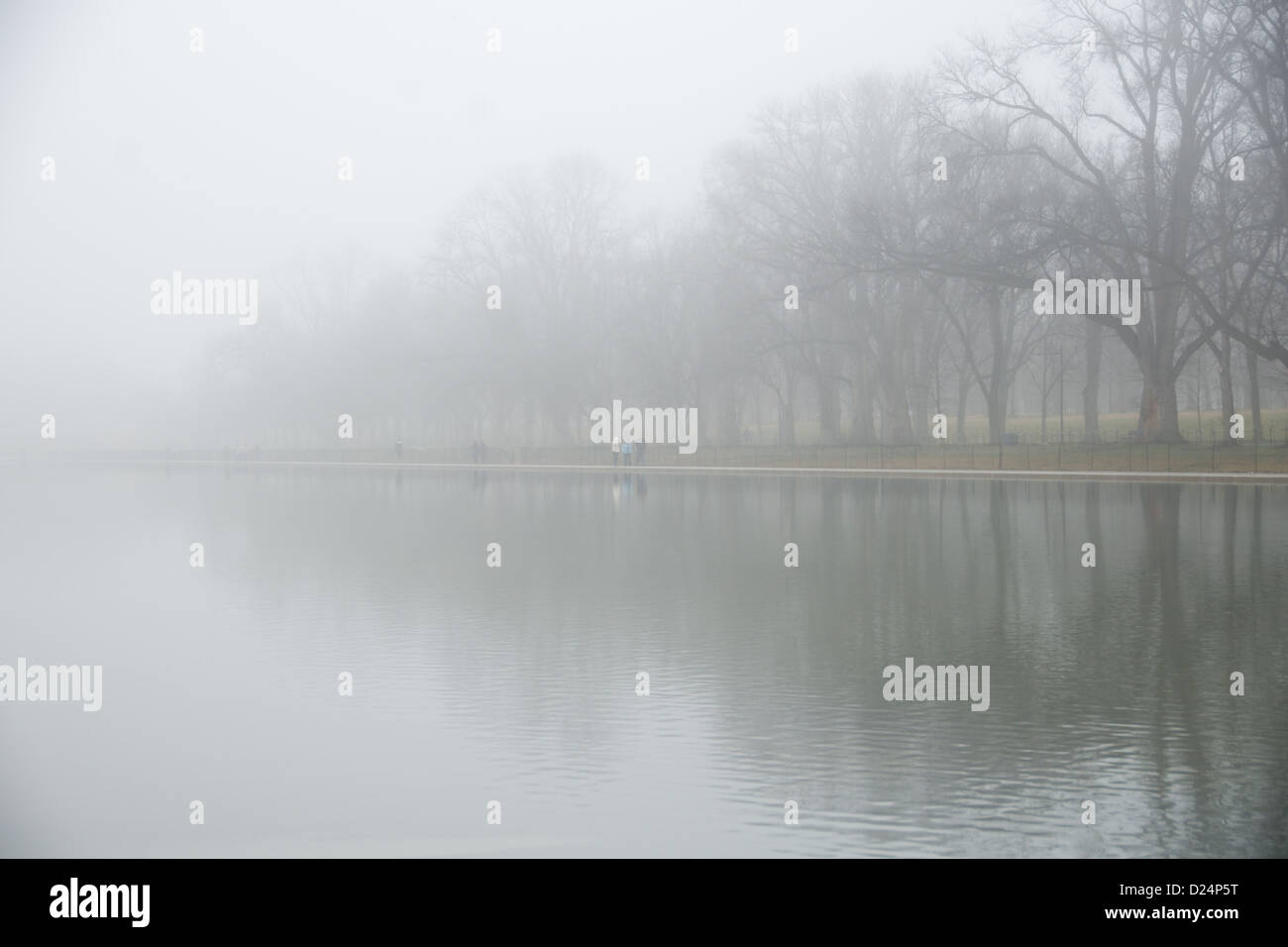 The Lincoln Memorial Reflecting Pool on a misty, cold winter's day in Washington DC. - Stock Image