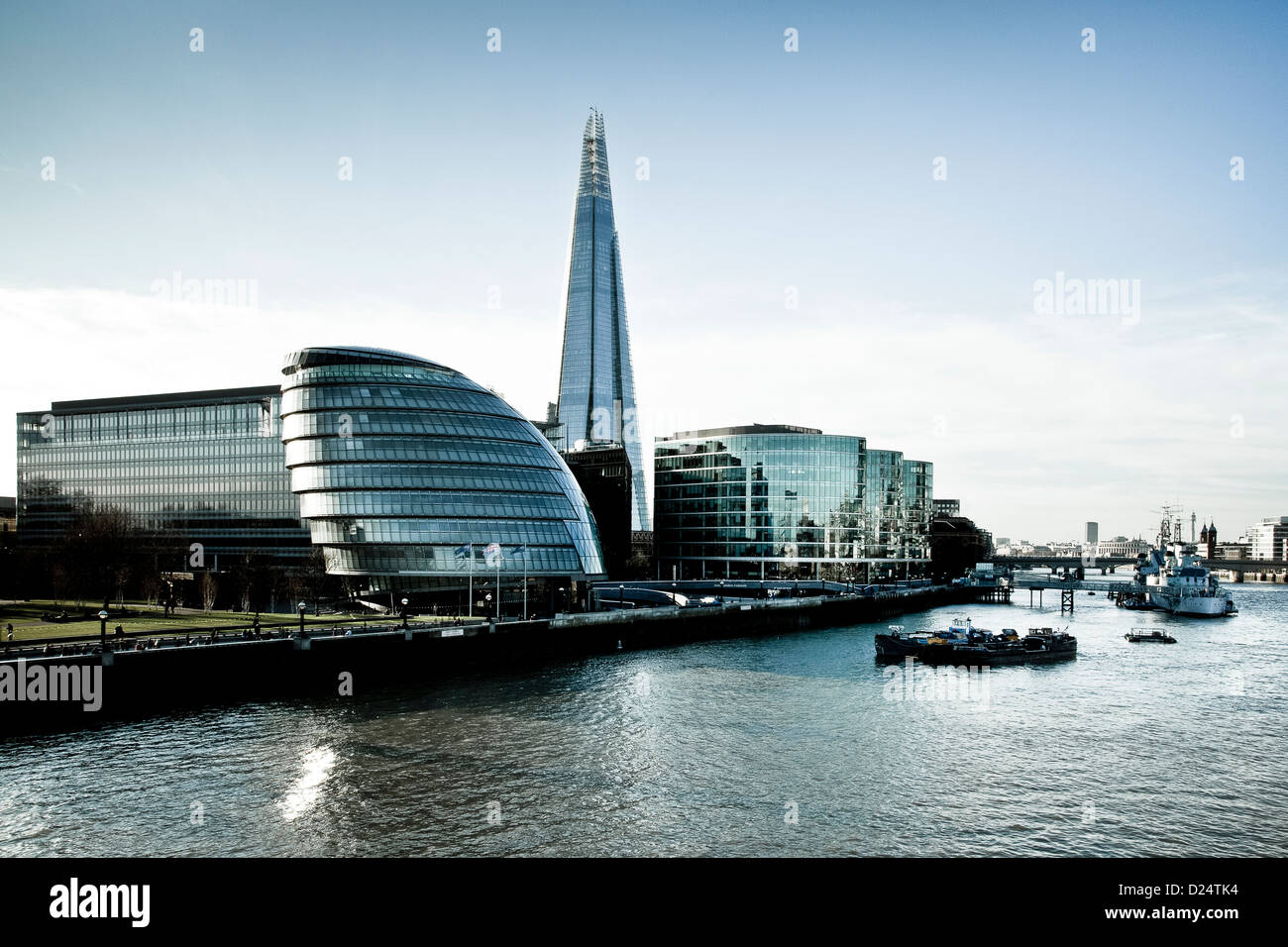View down the Thames along south bank showing the The Shard building GLC and modern office blocks, Southwark, London, - Stock Image