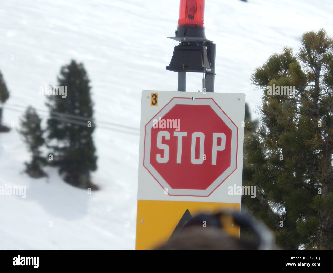 stop sign at a skiing resort in Austria, the Alps spring 2012 - Stock Image