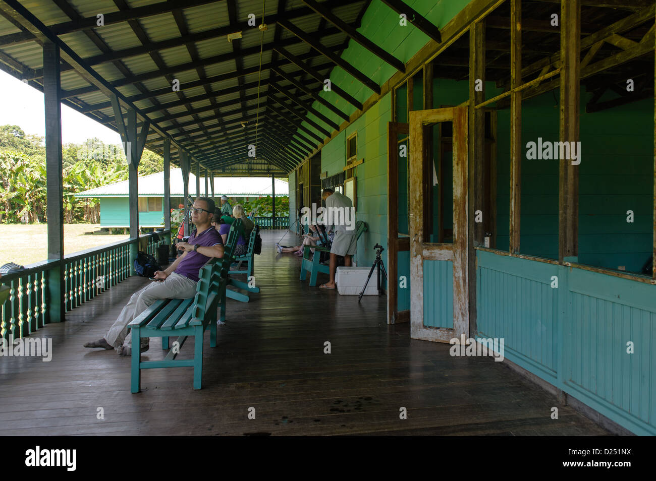 Tourists taking a rest on the veranda of the Sirena Ranger Station. Corcovado National Park. Costa Rica. - Stock Image