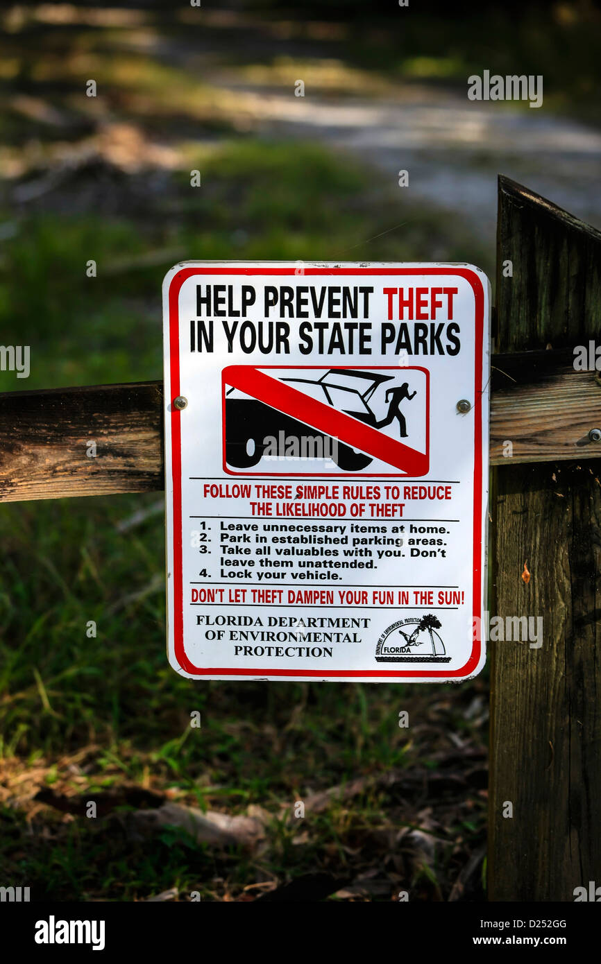 Help Prevent Theft seen in a Florida State Park sign - Stock Image