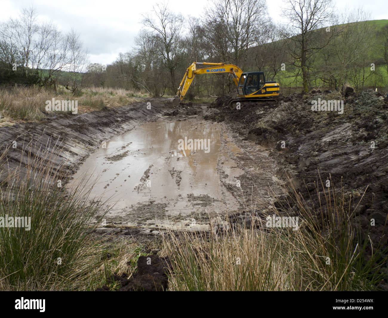 contractor with 360degree excavator digging wildlife pond on farm stock photo 52974038 alamy. Black Bedroom Furniture Sets. Home Design Ideas