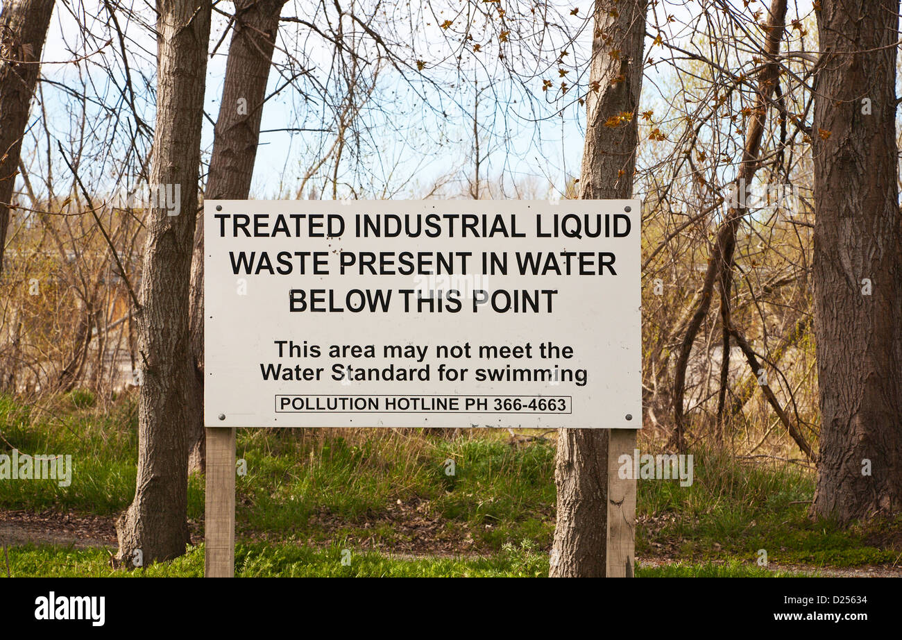 A notice warning of industrial liquid pollution in the Waimakariri river, Christchurch, Canterbury, South Island, - Stock Image