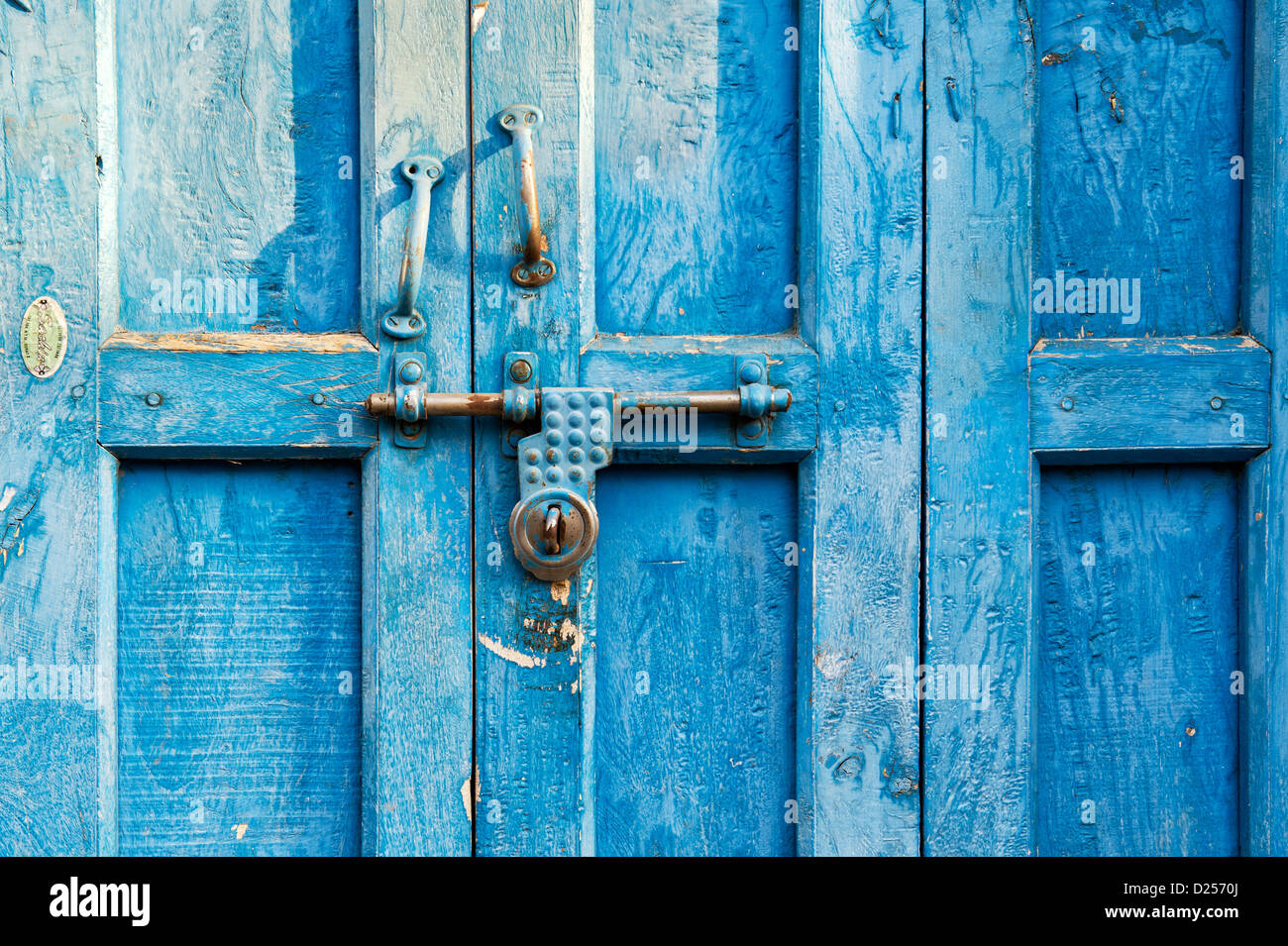 Old rural indian house blue doors. Andhra Pradesh,  India - Stock Image
