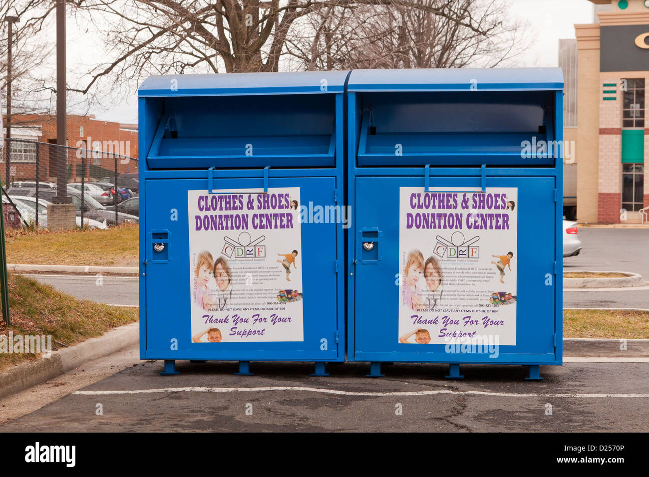 Clothes and shoes donation bins - USA - Stock Image