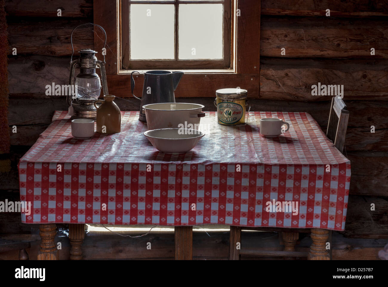 Red Table Cloth And Items On A Country Table