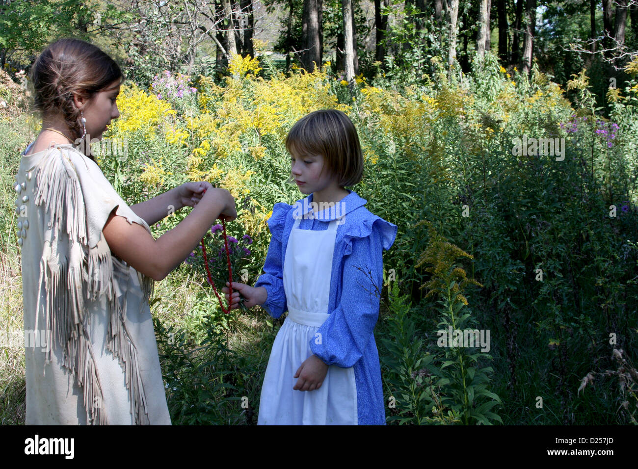A Native American Indian Girl Trading Beads For Flowers With A Child Stock Photo Alamy