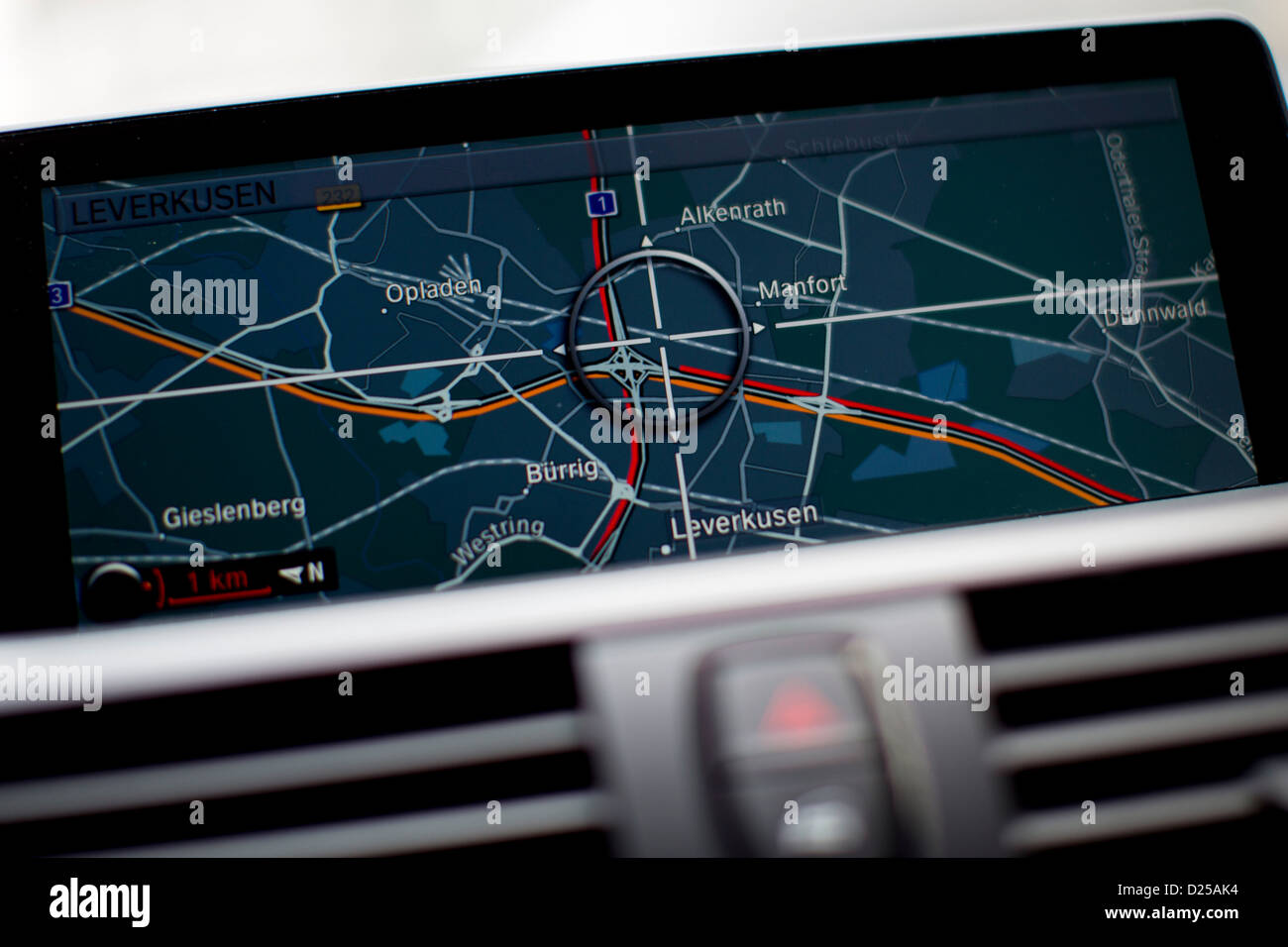 Yellow and red lines on the map of a navigation system indicates congested Autobahns A1 and A3 at the intersection - Stock Image