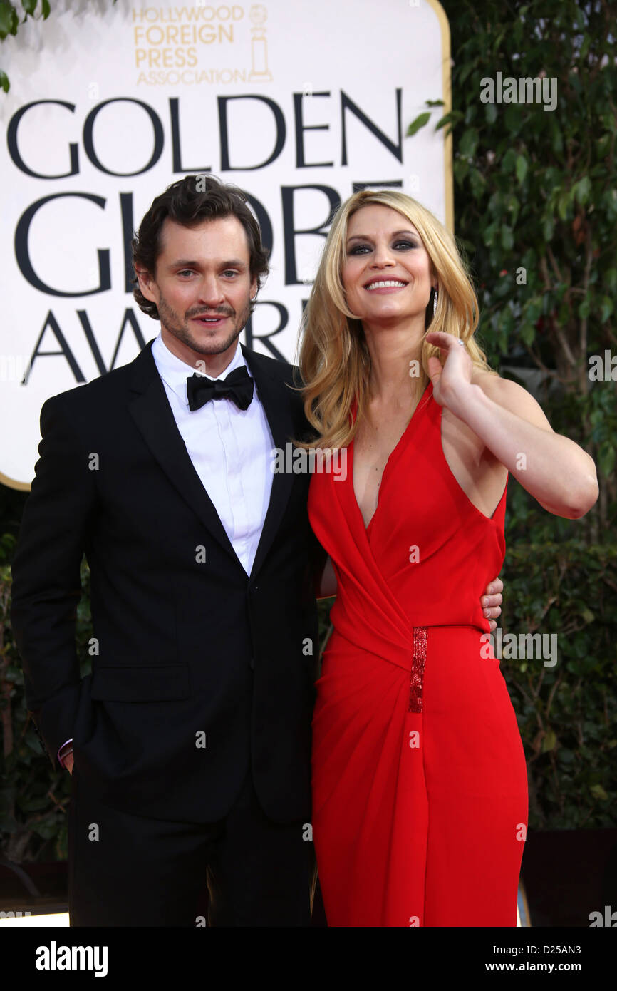 Actors Claire Danes and Hugh Dancy (l) arrive at the 70th Annual Golden Globe Awards presented by the Hollywood - Stock Image