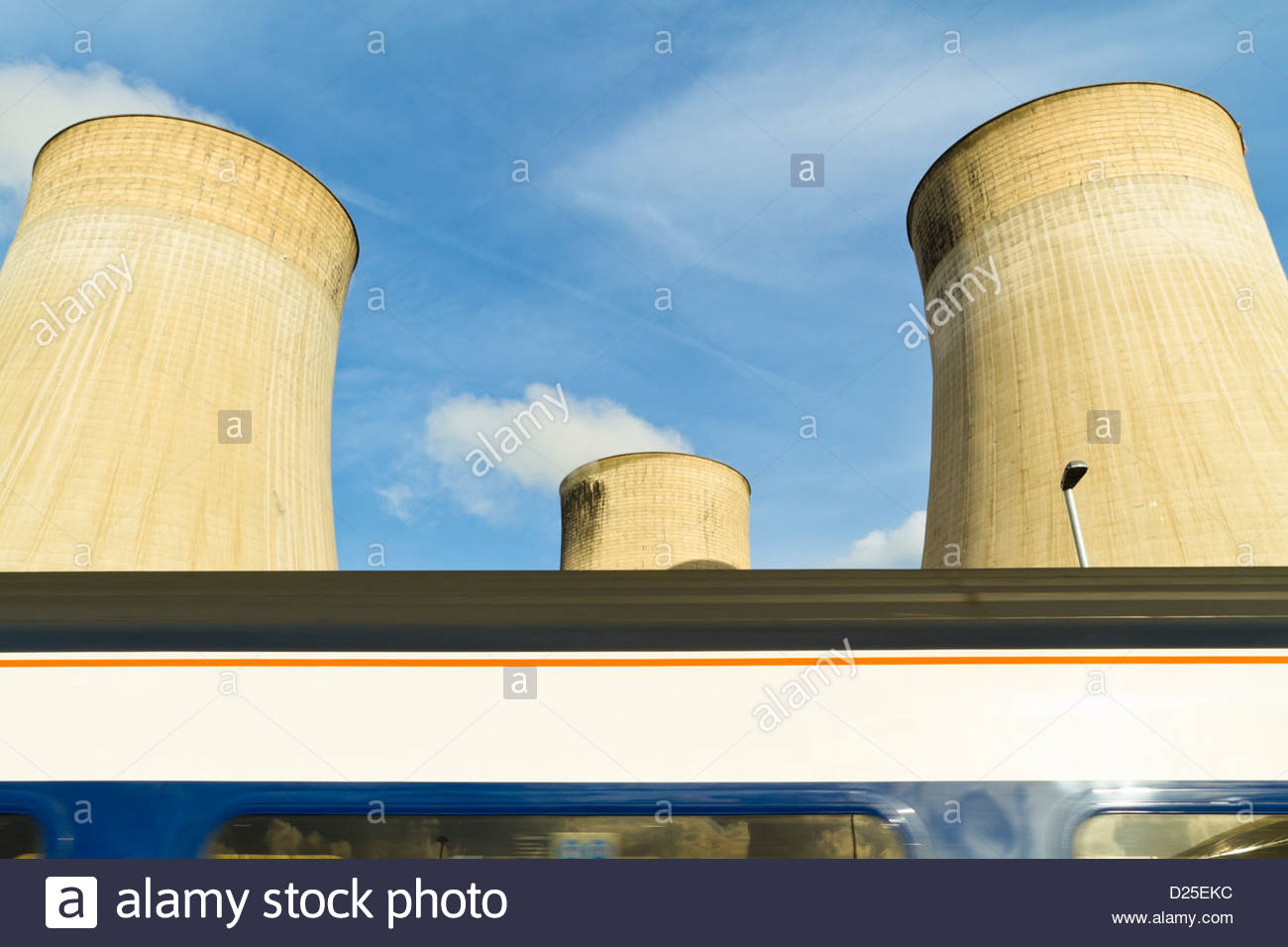 Train passing Ratcliffe on Soar power station cooling towers next to East Midlands Parkway Station, Nottinghamshire, - Stock Image