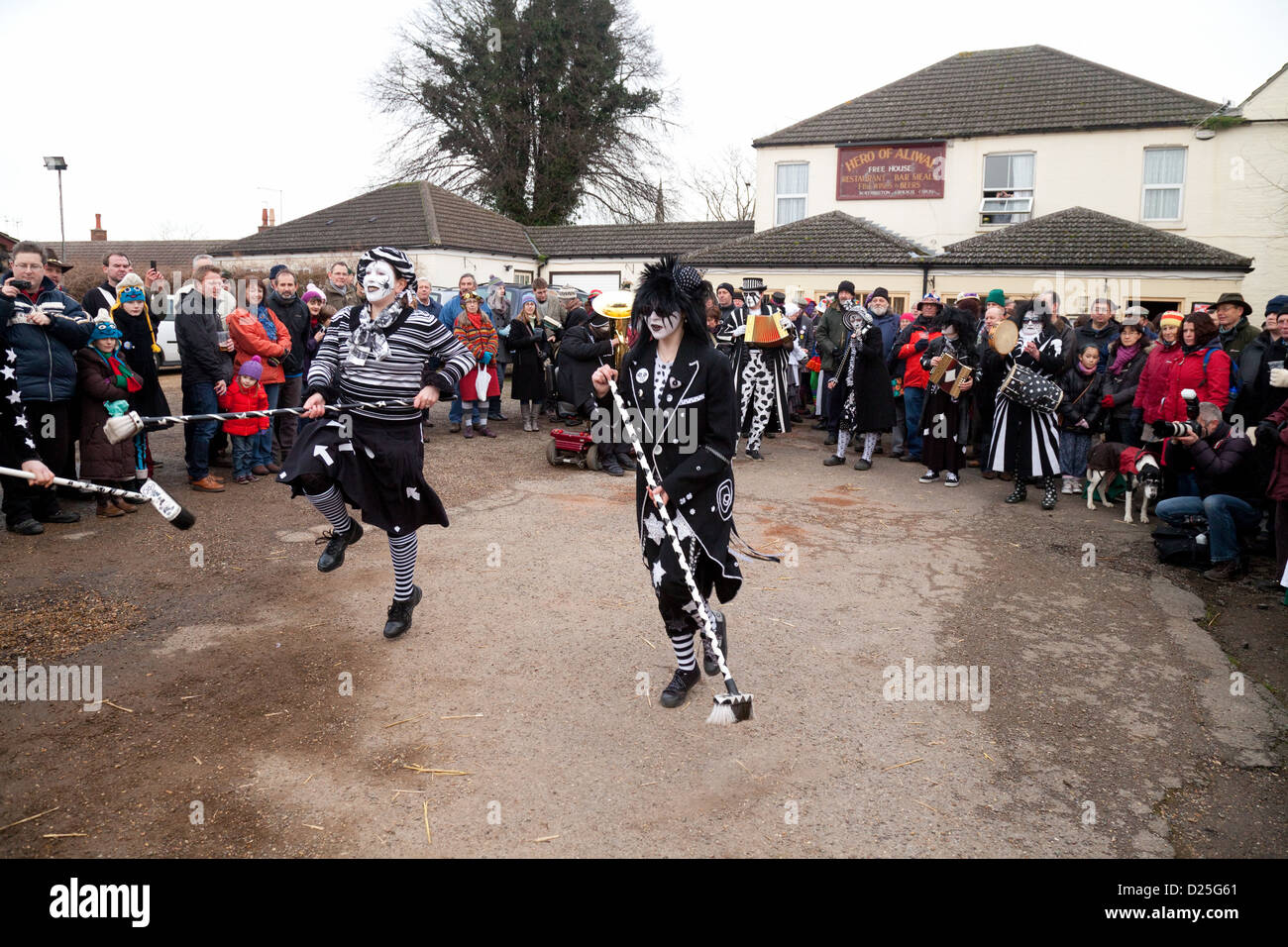 Morris dancing by Pig Dyke Molly dancers, Whittlesey Straw Bear festival, Cambridgeshire UK 2013 - Stock Image
