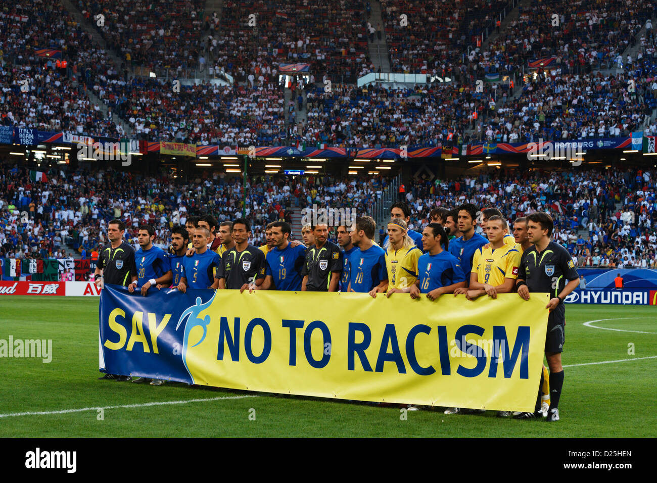 Italian and Ukrainian players line up with referees as part of an anti-racism campaign before World Cup quarterfinal - Stock Image