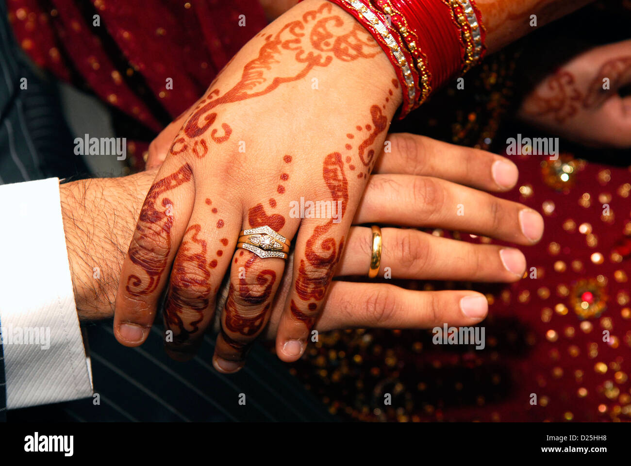 Mehndi Hands Couple : Newly married asian couple holding hands hounslow middlesex uk