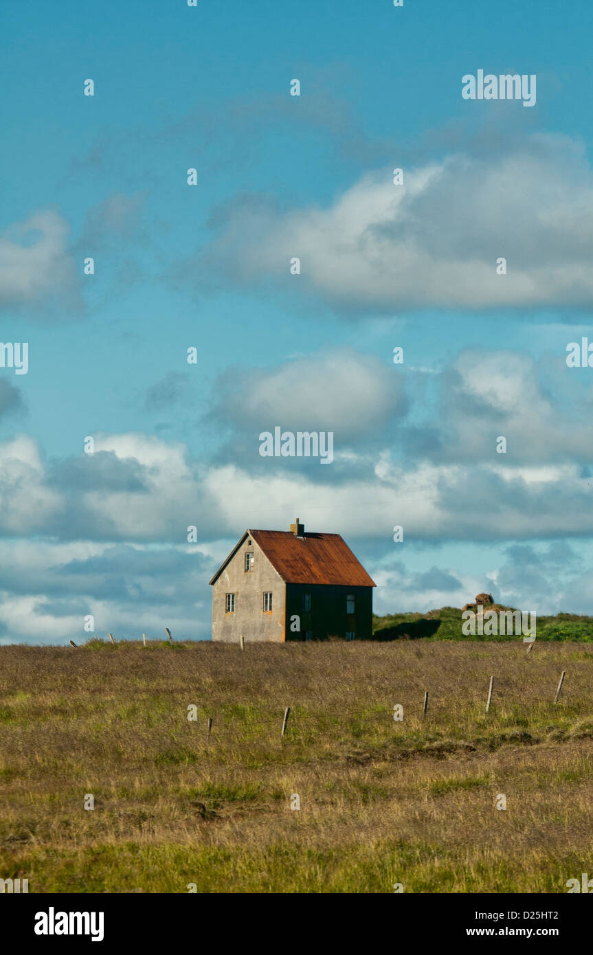 traditional farmhouse along the fjords of northeastern Iceland - Stock Image