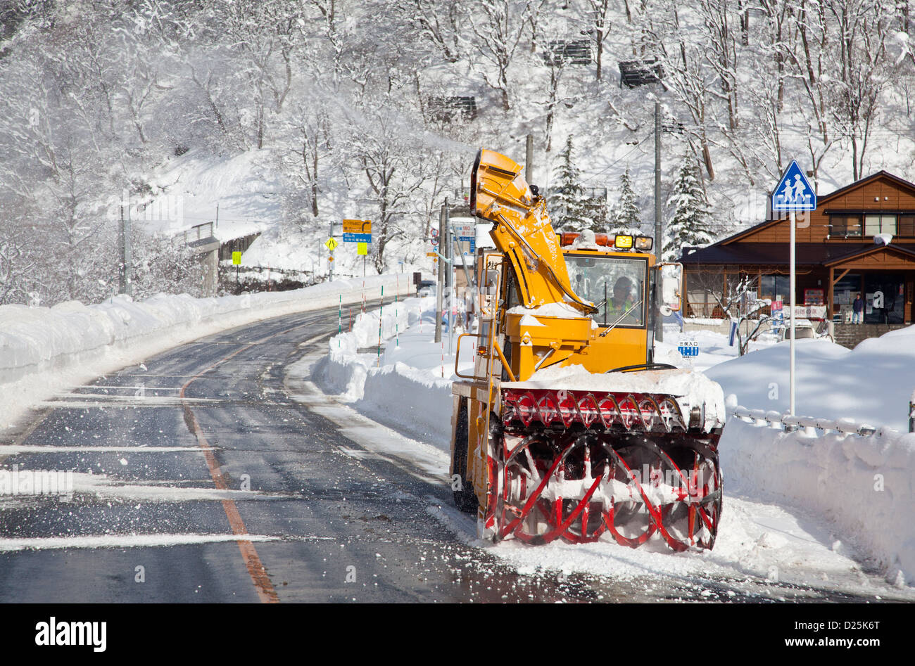 Snowploughs clearing heavy snow from roads in rural Niigata. Japan Saturday January 5th 2013 - Stock Image