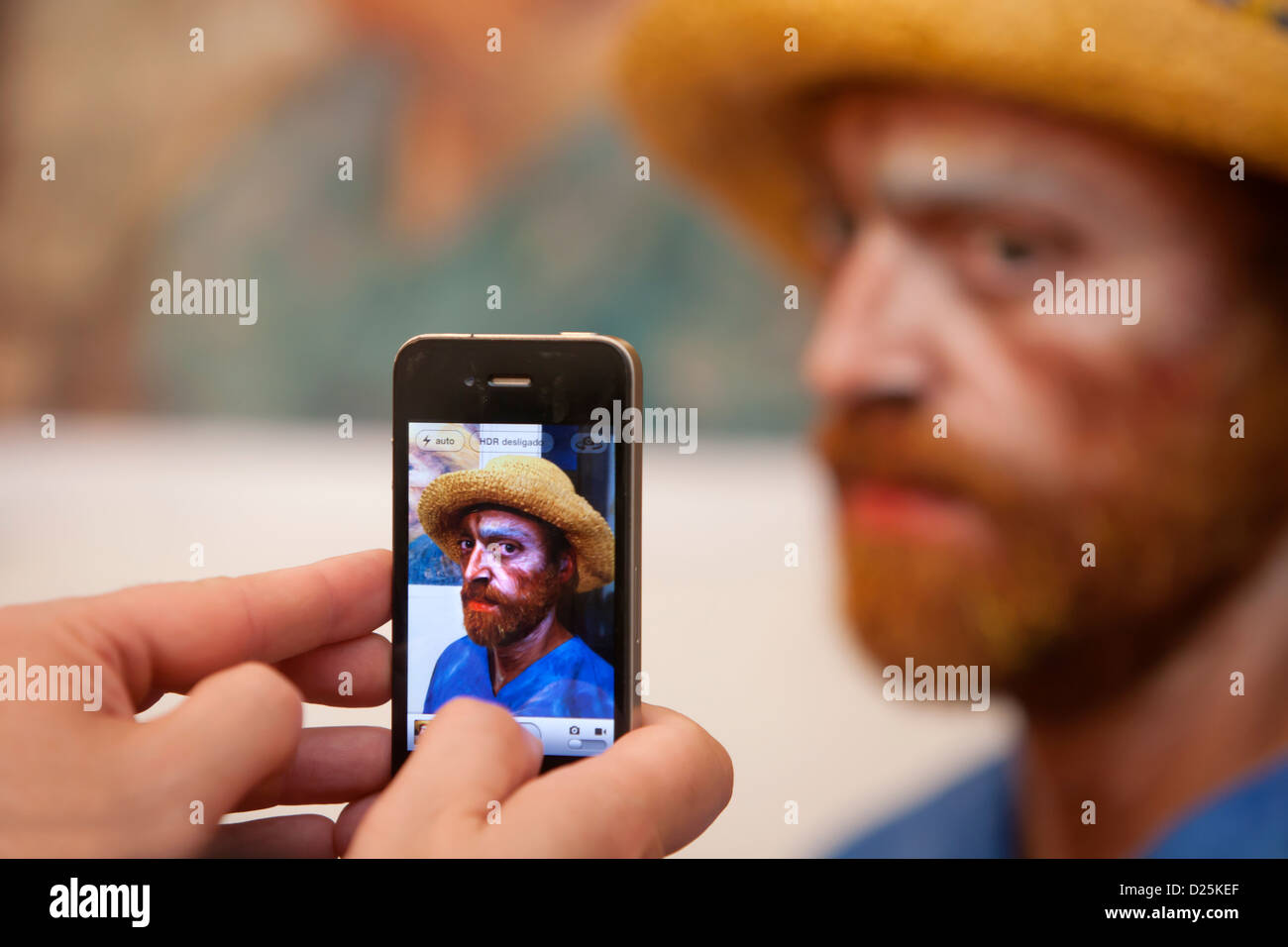 Taking a photo of Van Gogh. - Stock Image
