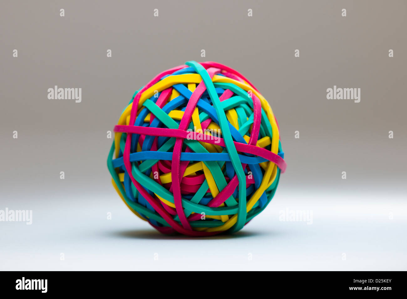 Colourful rubber band ball - Stock Image