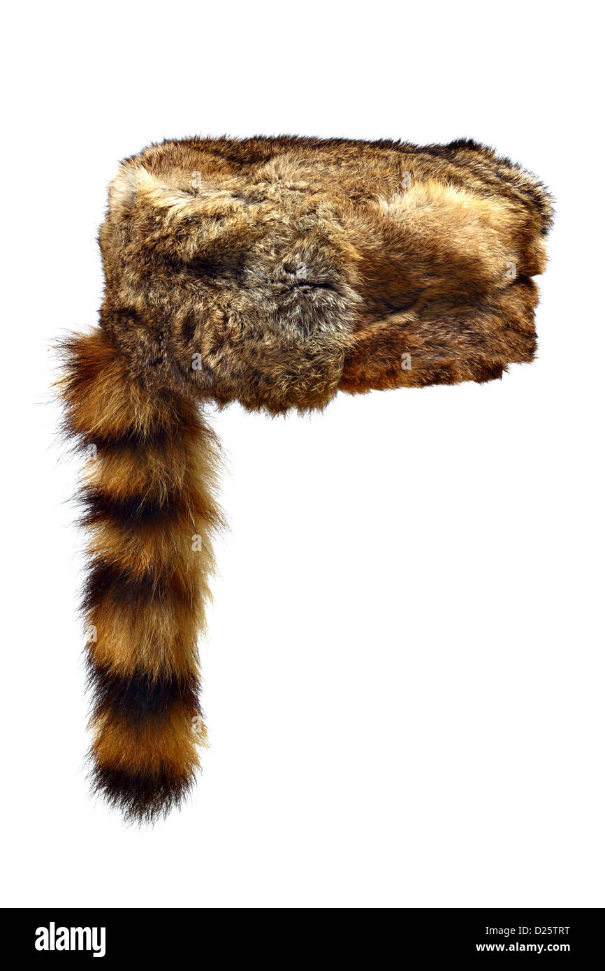 Fur Crockett hat with a raccoon tail isolated on white background - Stock Image