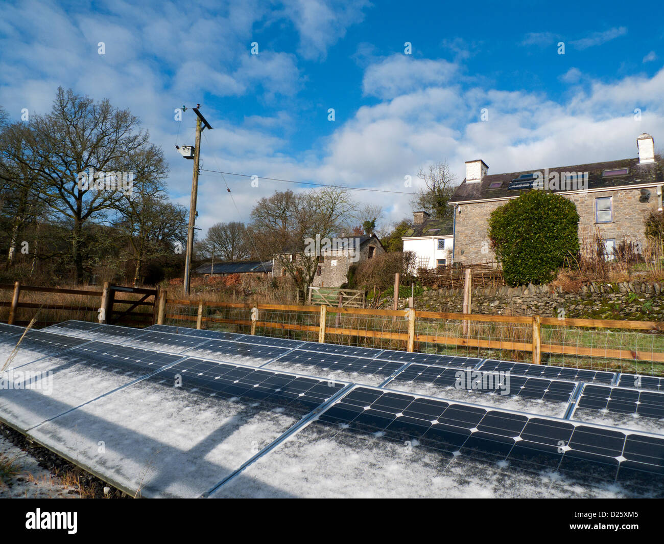 Free standing photovoltaic solar panels on smallholding land in West Wales, UK - Stock Image