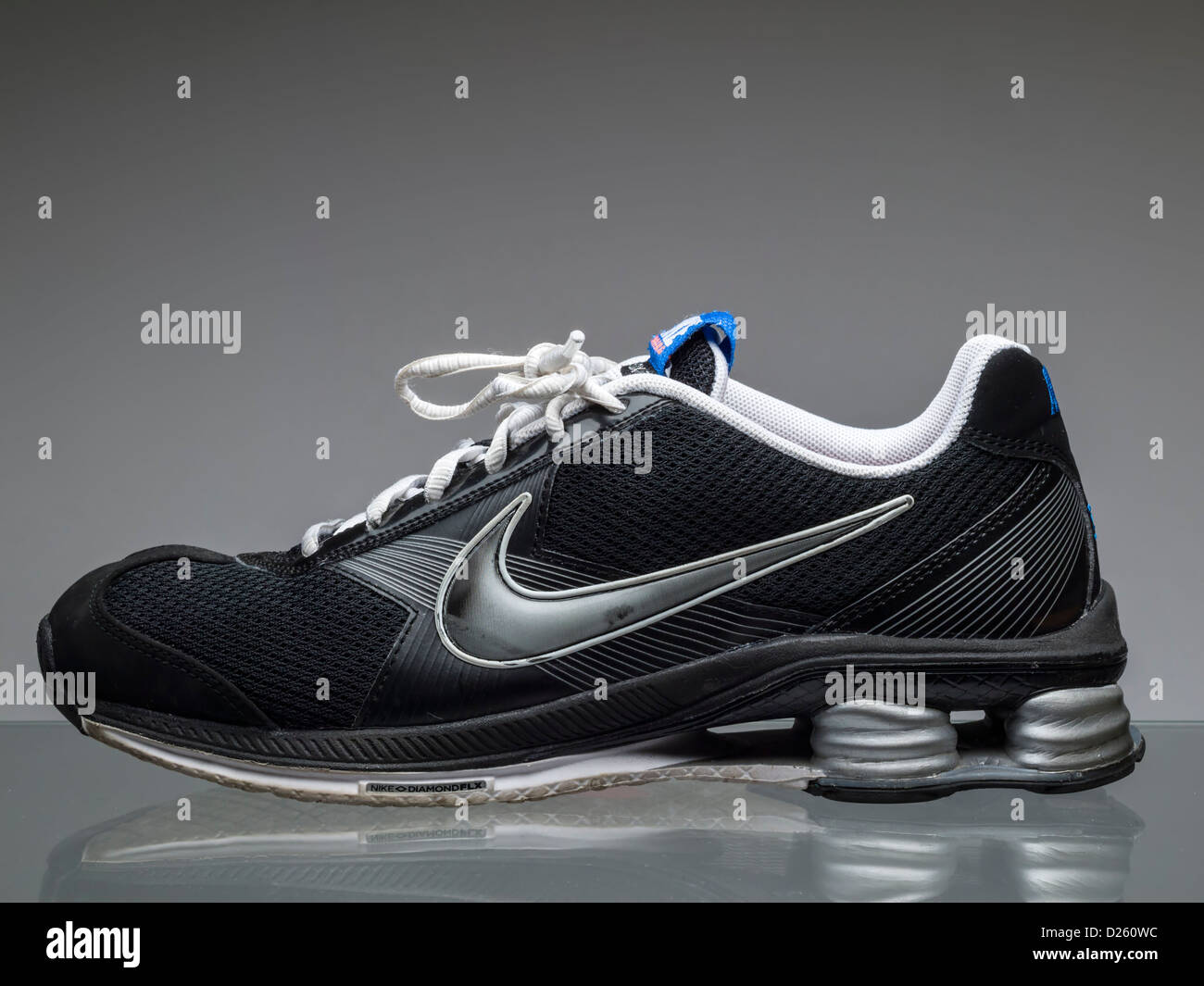 Black Nike running shoe - Stock Image