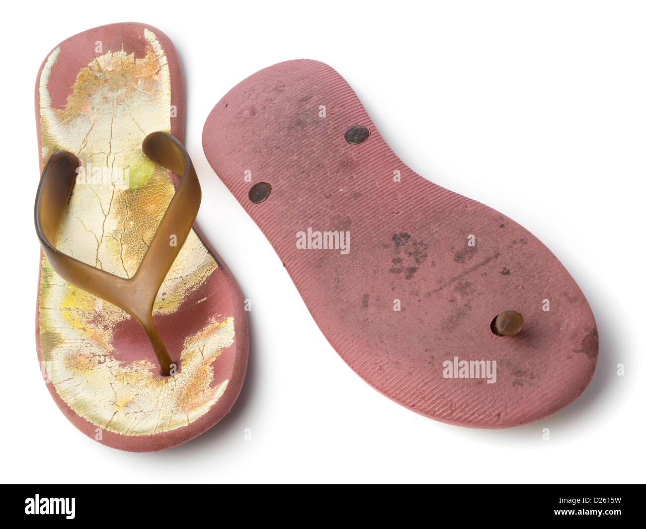Pair of worn old plastic flip flops isolated on white background - Stock Image