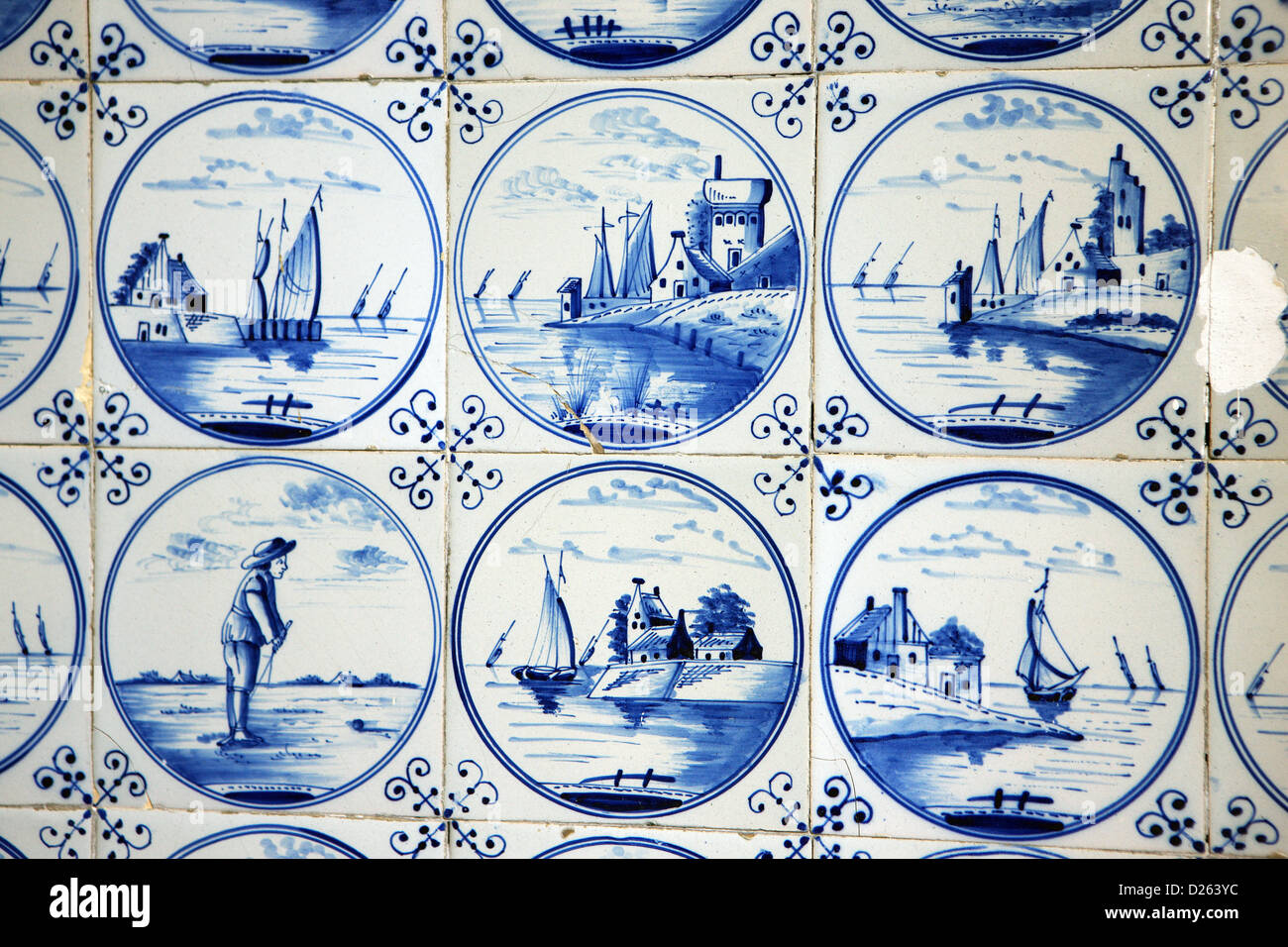 Dutch blue and white Delftware tiles at the entrance to a building in Amsterdam - Stock Image