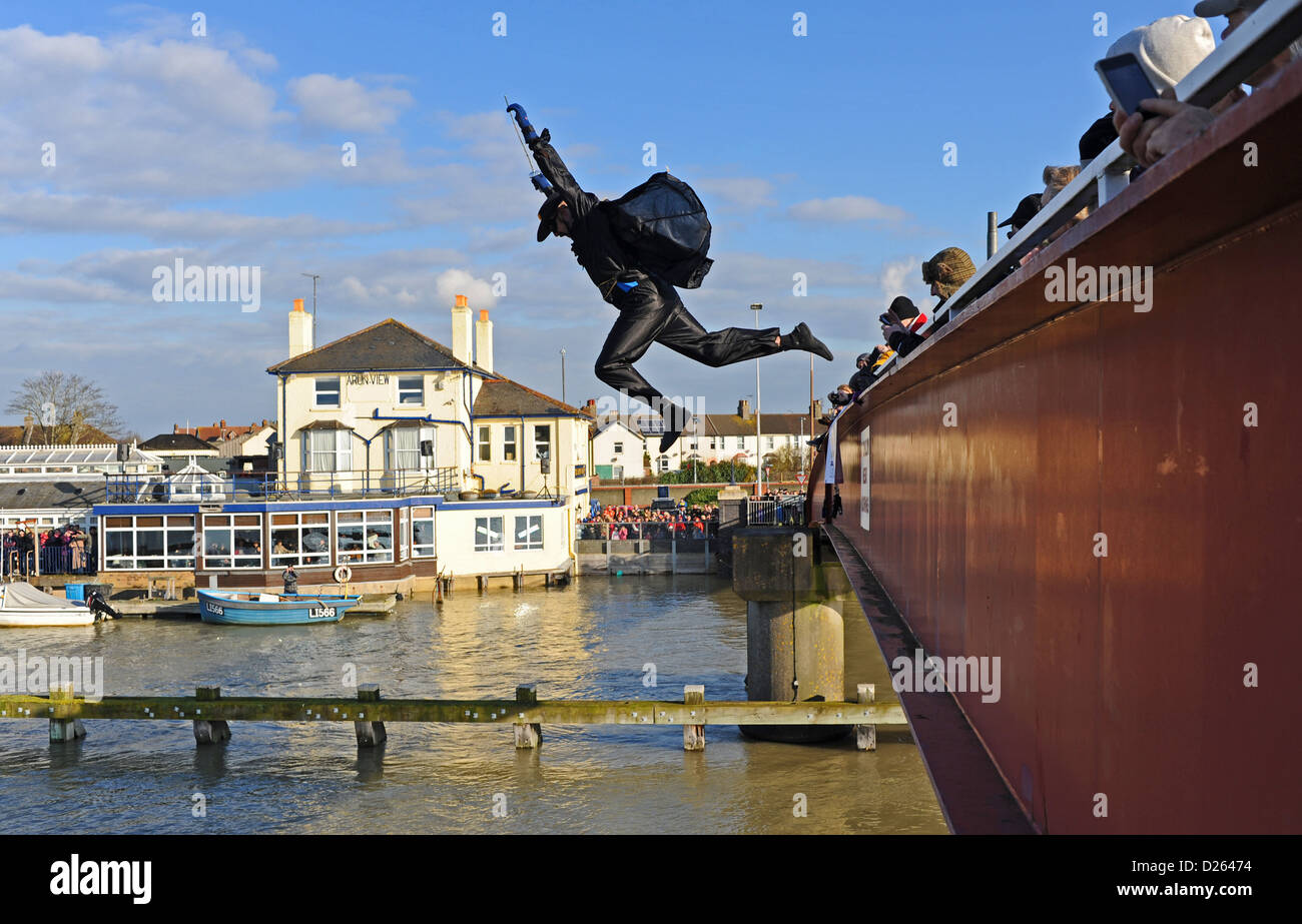Man dressed as Zoro taking part in the annual Littlehampton Leap into the River Arun from the footbridge - Stock Image