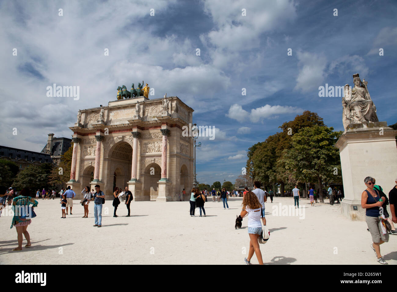 Tourists walking toward the arc du Carousel in Paris. France - Stock Image