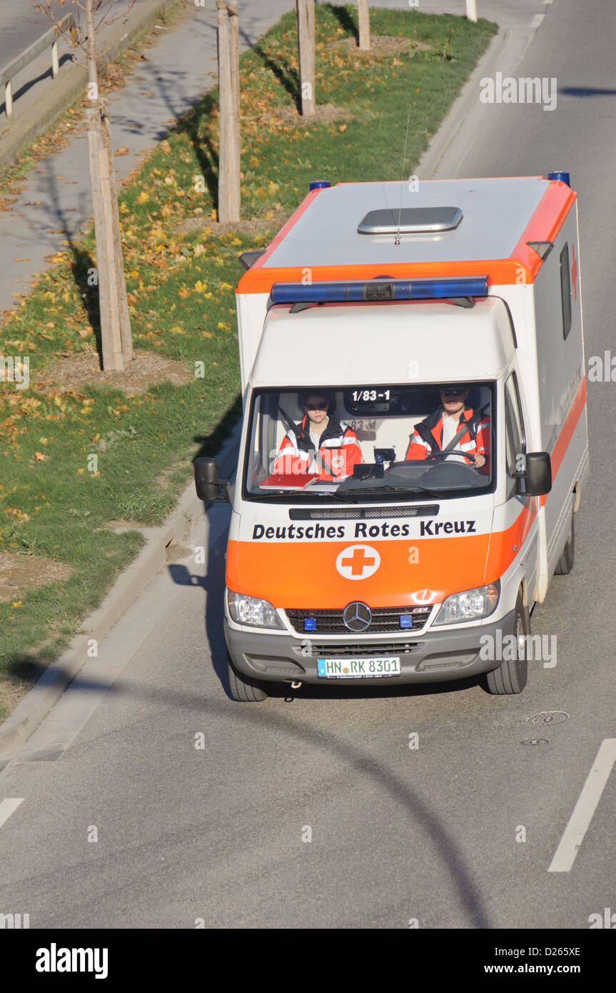 Ambulance coach German Red Cross with two paramedics one female paramedic one male paramedic – Heilbronn, South - Stock Image