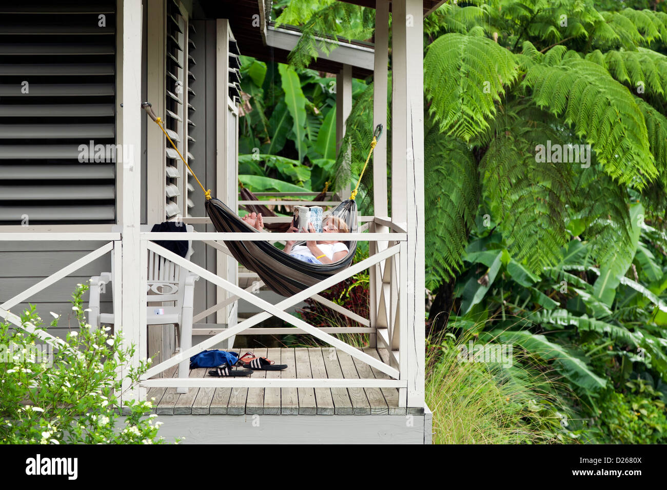 Woman reading on hammock, Casa Grande Mountain Retreat, Utuado, Puerto Rico - Stock Image