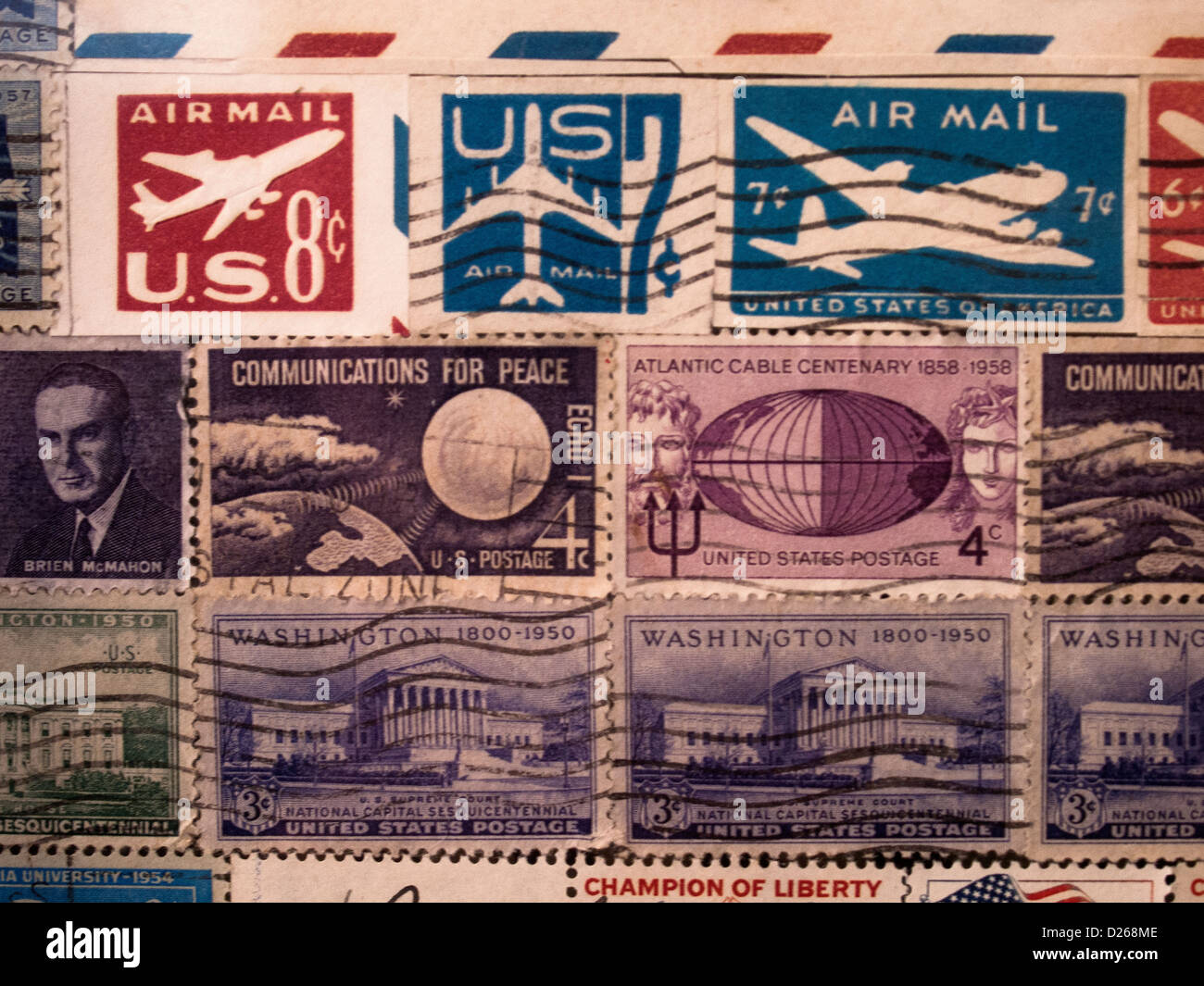 Canceled stamps from the 1950's, show propeller and jet planes in stamps that just cost a few cents. - Stock Image