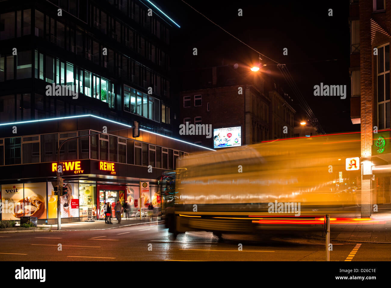Vivid night scenery showing light traces of a truck turning off in long exposure at an intersection on Nov. 8, 2012 Stock Photo