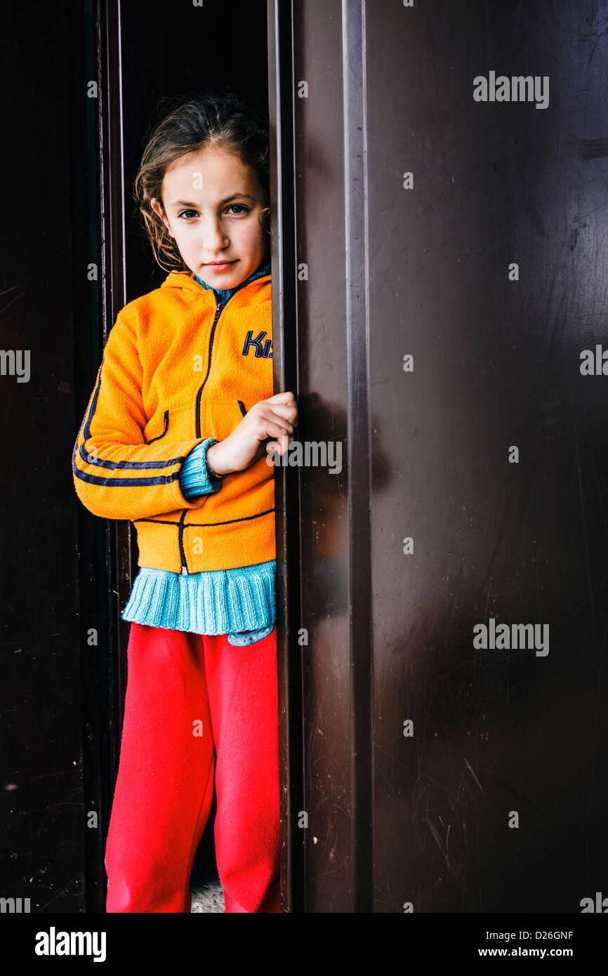 One of many, a Kanun prisoner child, living locked at home under the menace of Gjakmarrja (Blood Feud). Bardhaj, - Stock Image