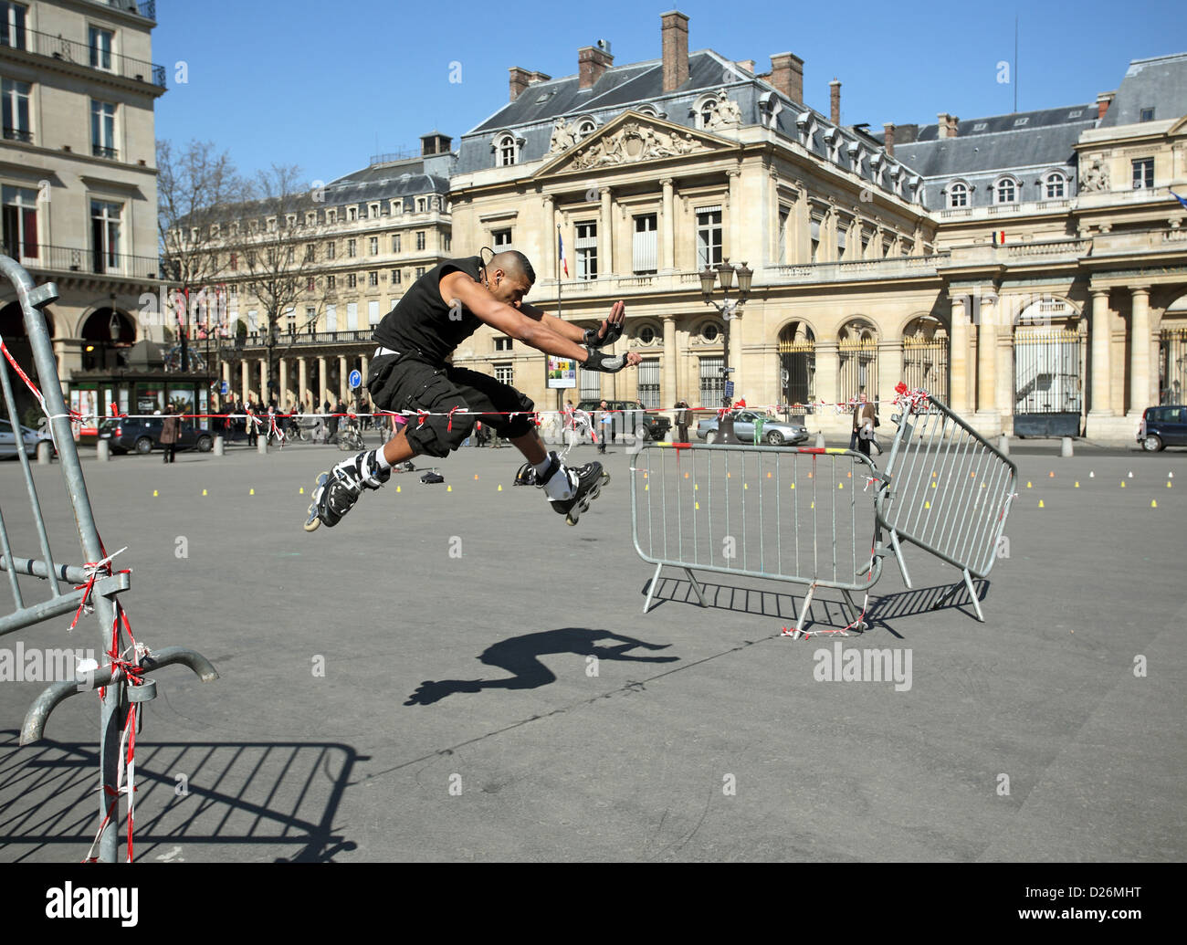 Paris, France, on skates man jumps over a strained - Stock Image