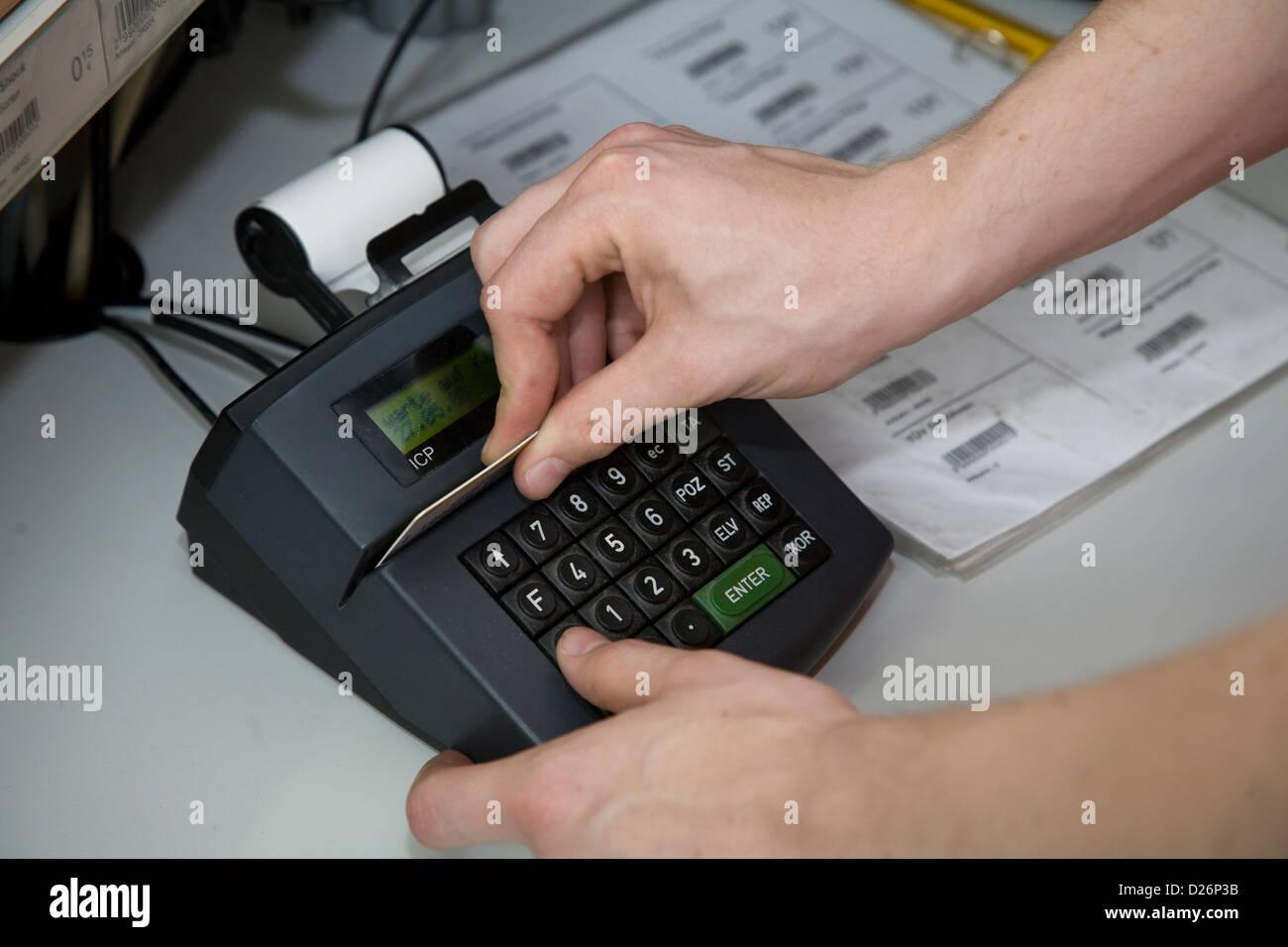 Euskirchen, Germany, a trainee serves a Kartenlesegeraet - Stock Image