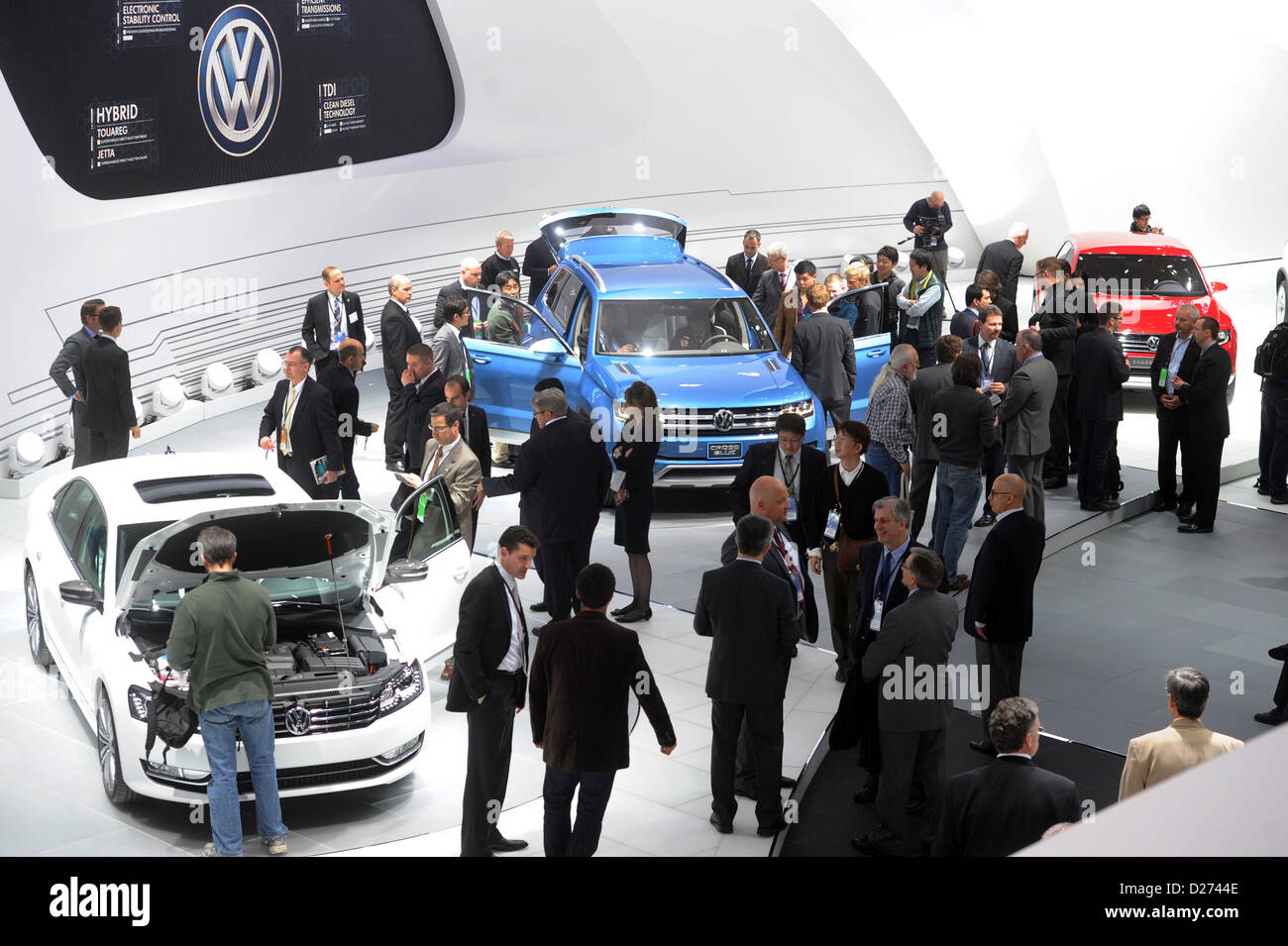 Visitors examine the new Volkswagen concept cars during the North American International Auto Show (NAIAS) in Detroit, - Stock Image