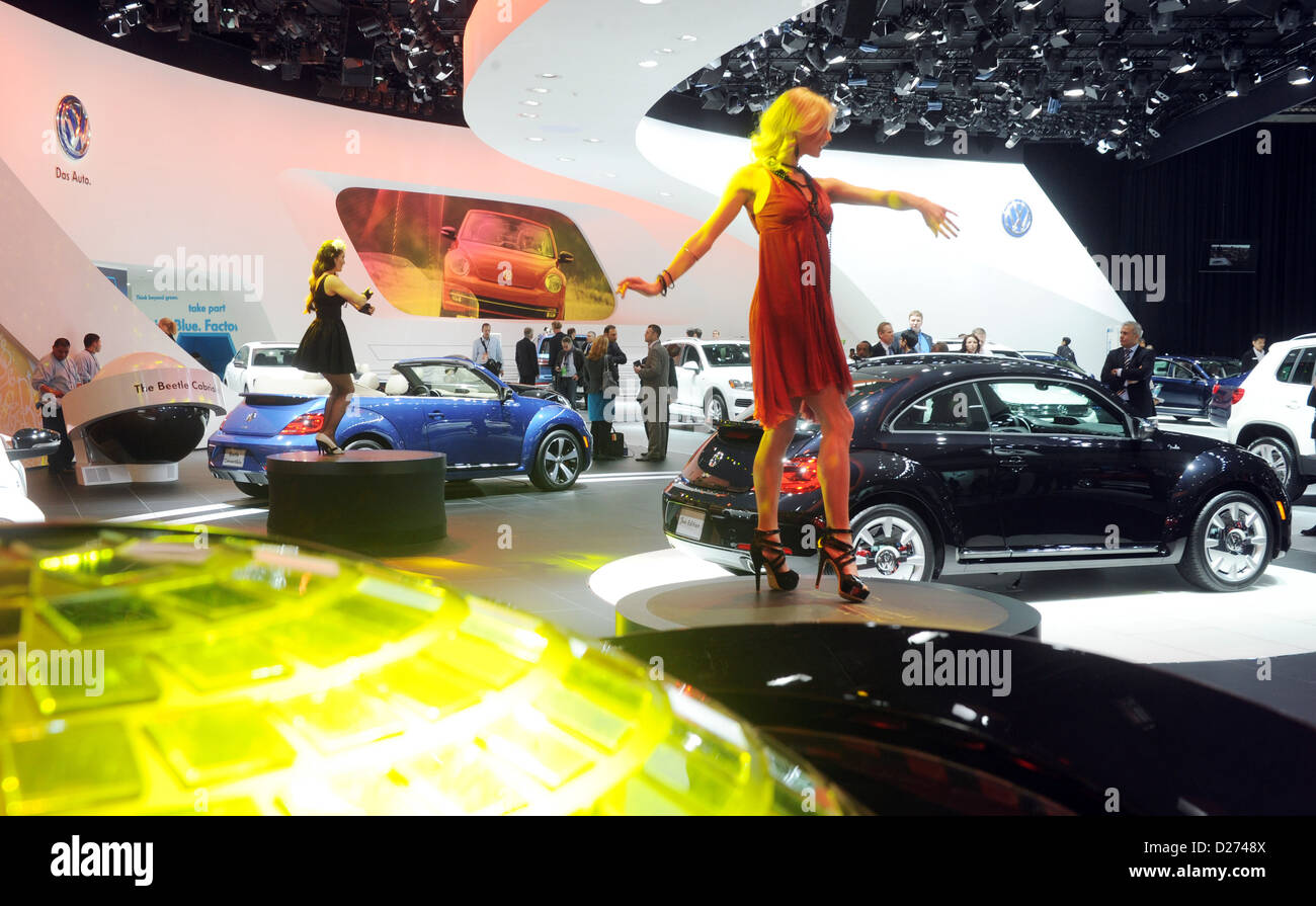 Models stands at the stand of VW on the second press day at the North American International Auto Show (NAIAS) in - Stock Image