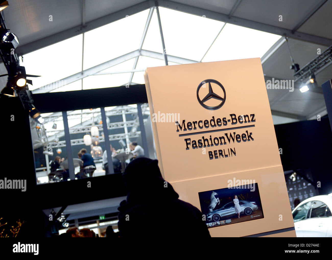 Visitors pass through the Mercedes-Benz Fashion Week tent in Berlin, Germany, 15 January 2013. The presentations - Stock Image