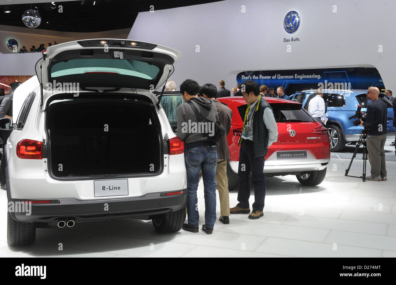 Visitors mingle between the different concept cars at the Volkswagen stand during the North American International - Stock Image
