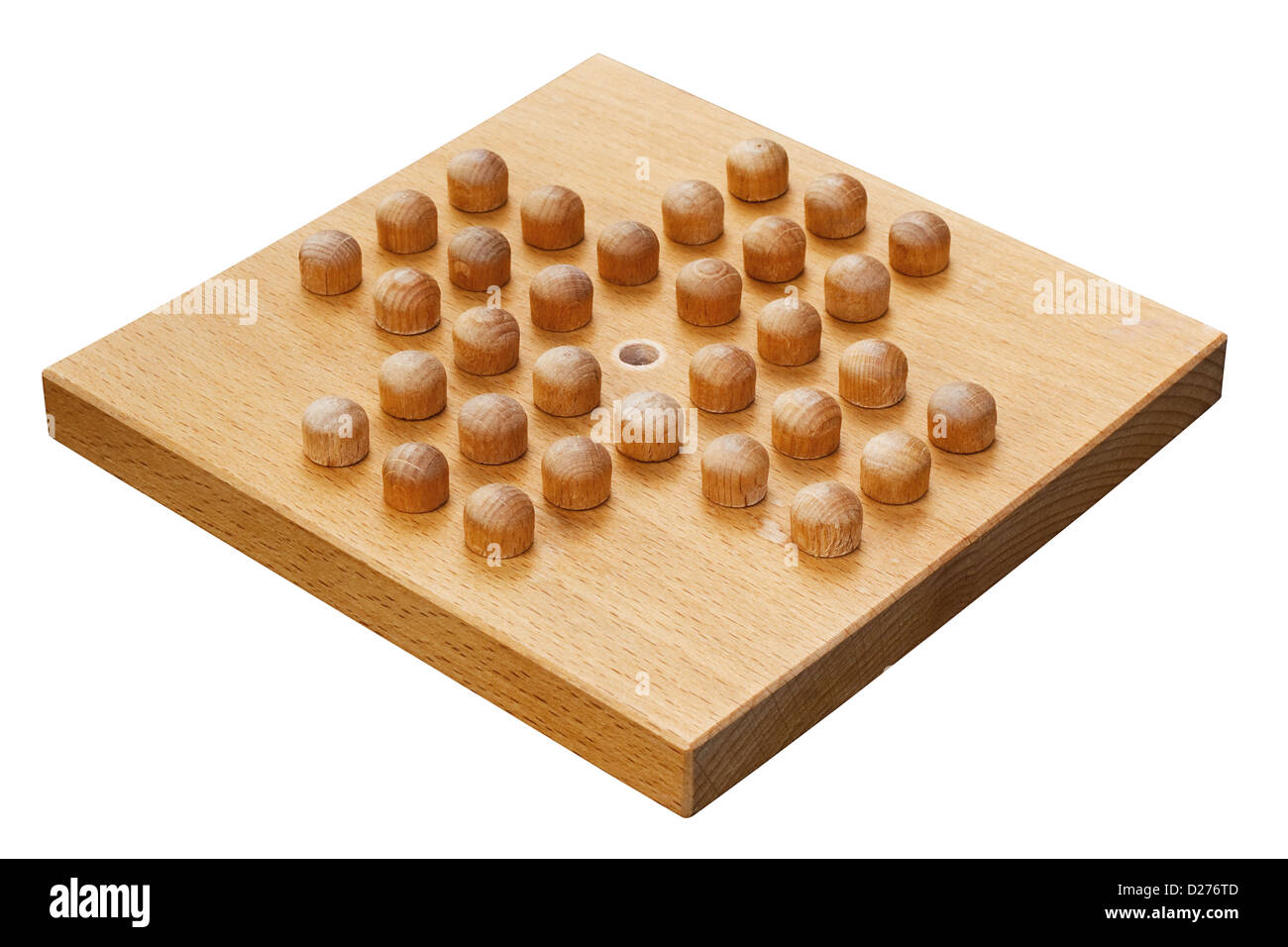 wooden peg solitaire board crafted from wood a popular indoor puzzle - Stock Image
